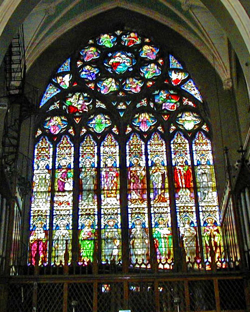 "The sanctuary leadlight window at the Church of St John the Baptist and St Augustine (""John's Lane"")  in Dublin"