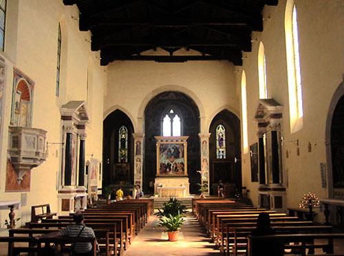 The nave of the church, with the Gozzoli frescoes in the distance.