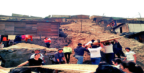 Augustinian high schoolers building houses for the poor near Lima. Peru