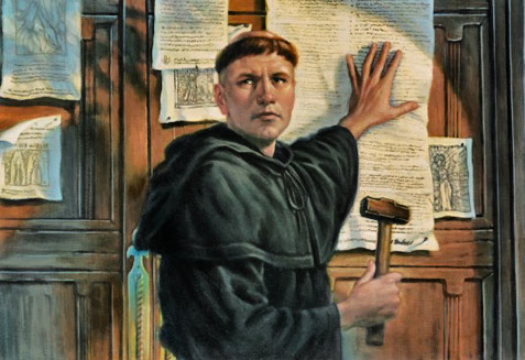 The monk Martin Luther nailing his theses on cathedral door in 1517
