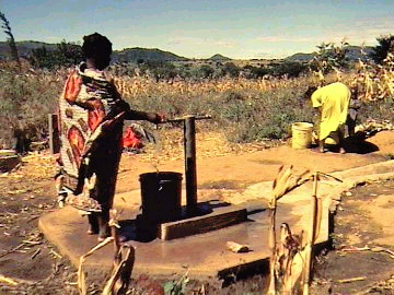 Drawing water from a well in Africa